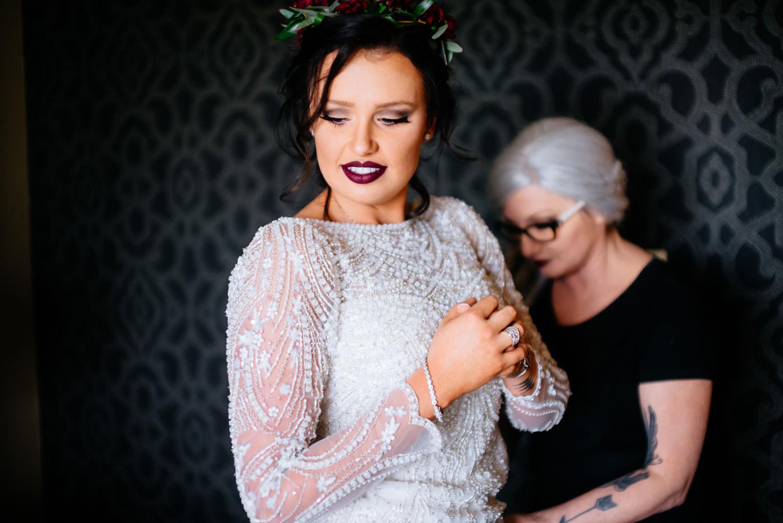mom helping bride put on dress chestnut hotel