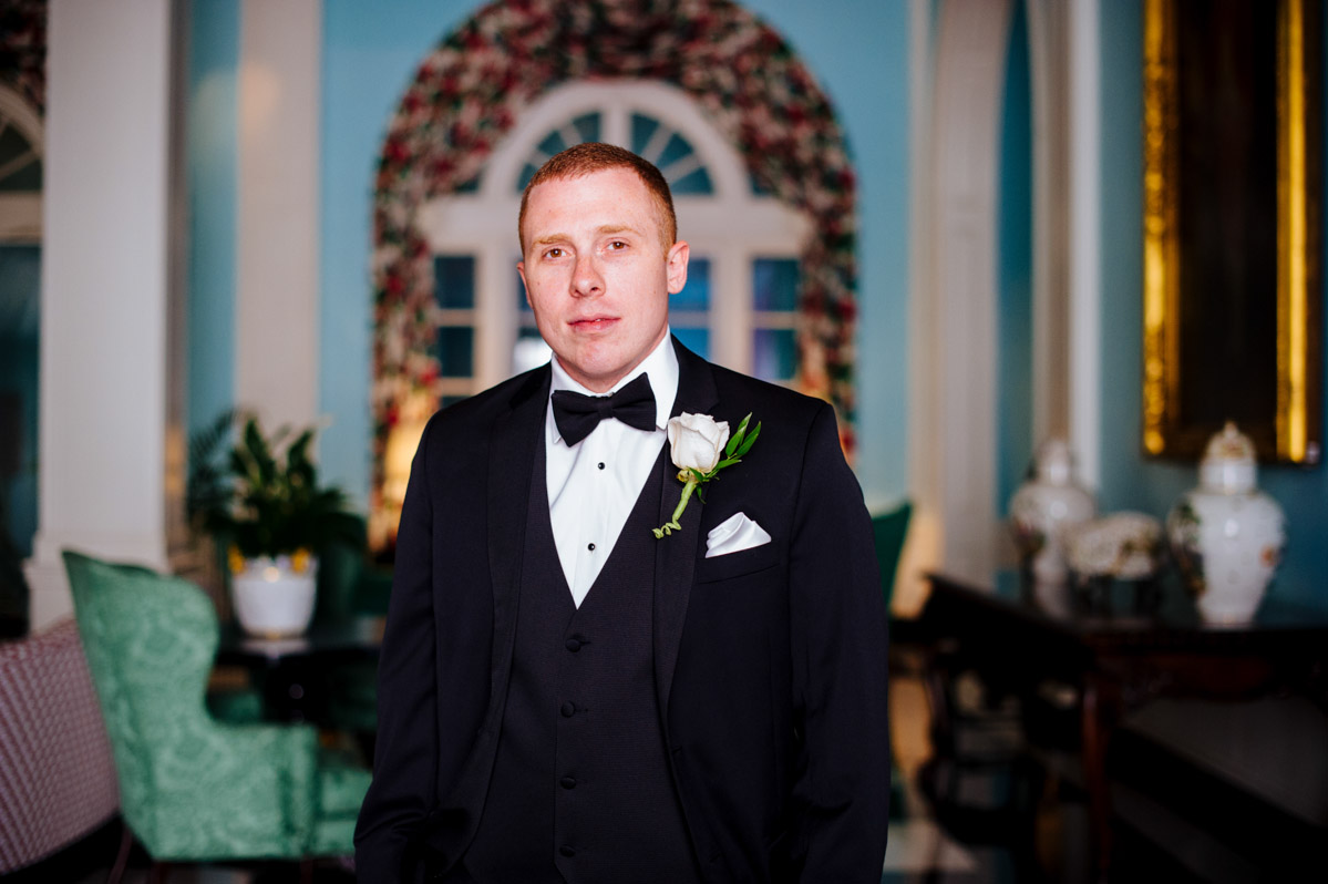 sophisticated groom portrait at greenbrier resort by best charleston wv wedding photographers the oberports