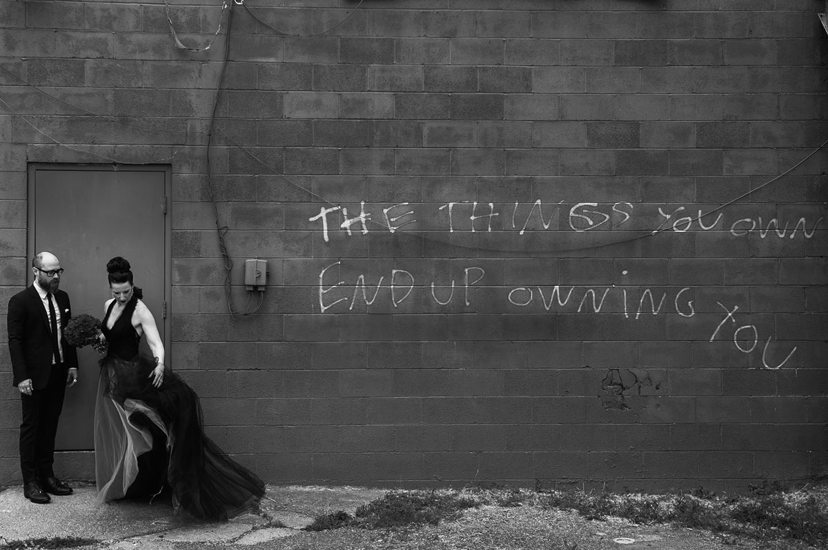 bride groom portrait in front of graffiti vera wang black dress by wv photographers the oberports1