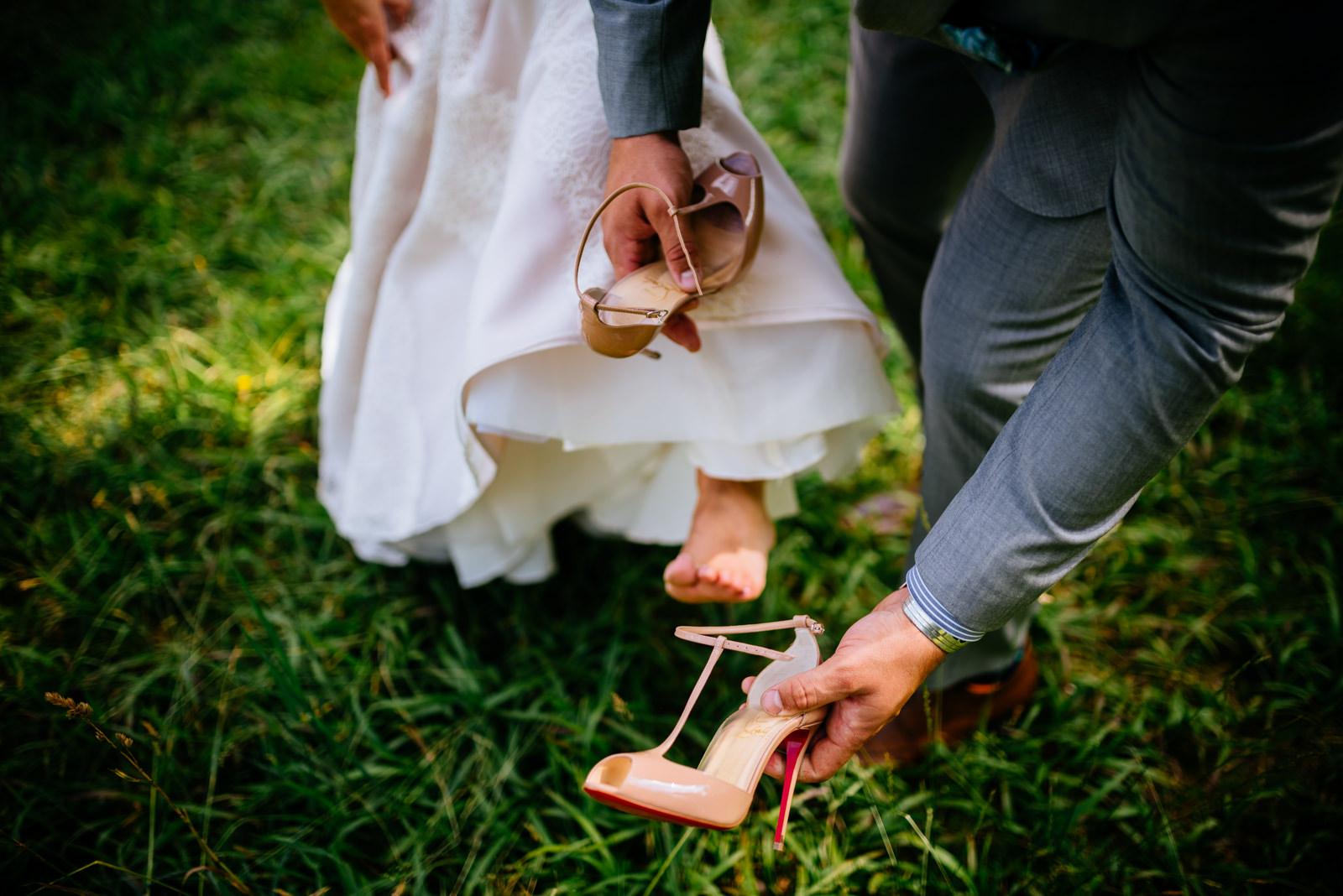 groom puts on bride shoes