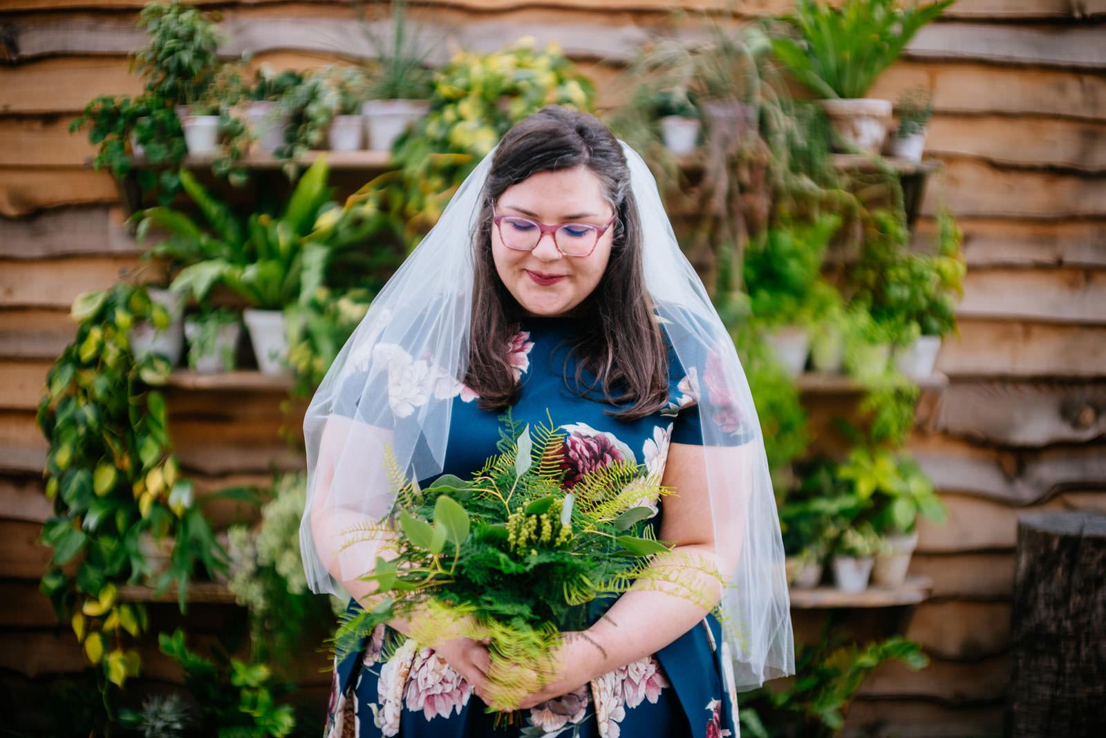 bridal portrait in greenhouse terrain elopement