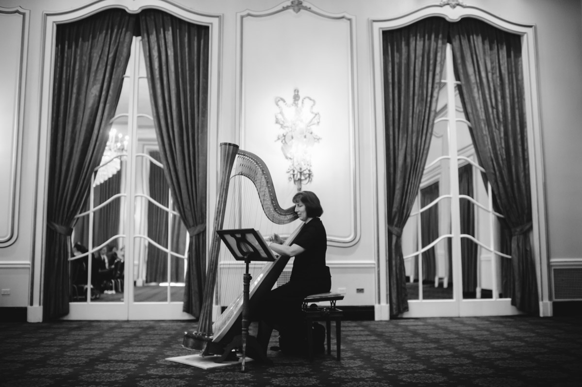harp player in crystal room elegant greenbrier resort wv wedding by the oberports