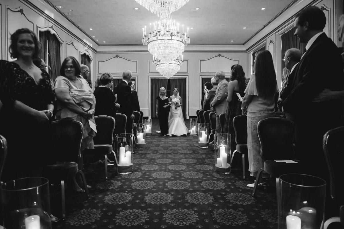 bride entering classy crystal room wedding ceremony at greenbrier resort wv