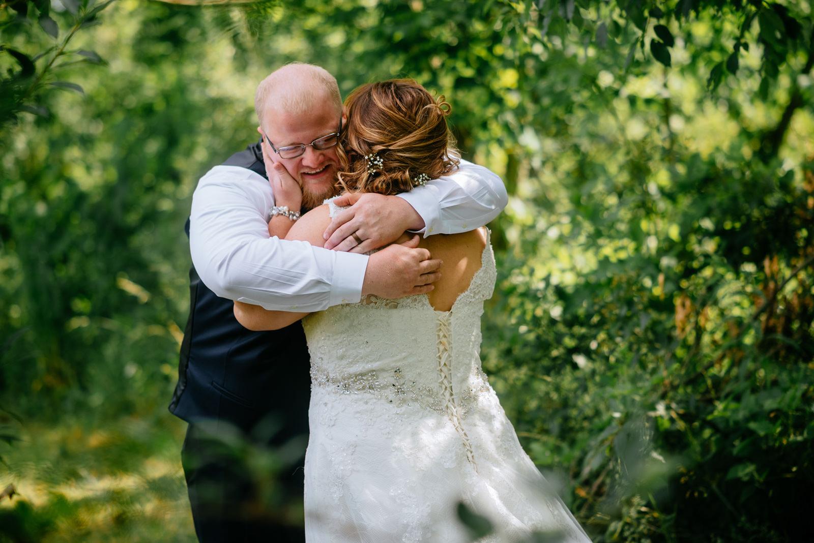 bride groom hugging first look