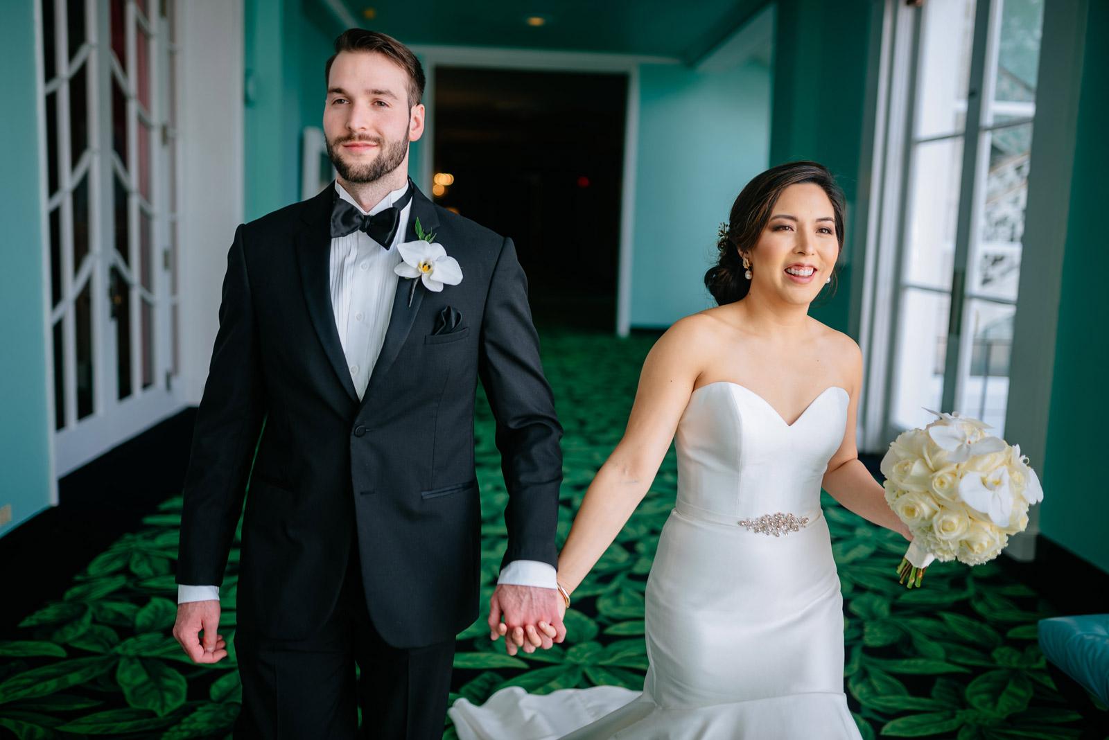 bride groom walking through greenbrier resort