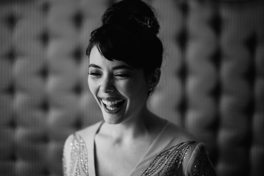bride laughing candid picture by best wv wedding photographers the oberports