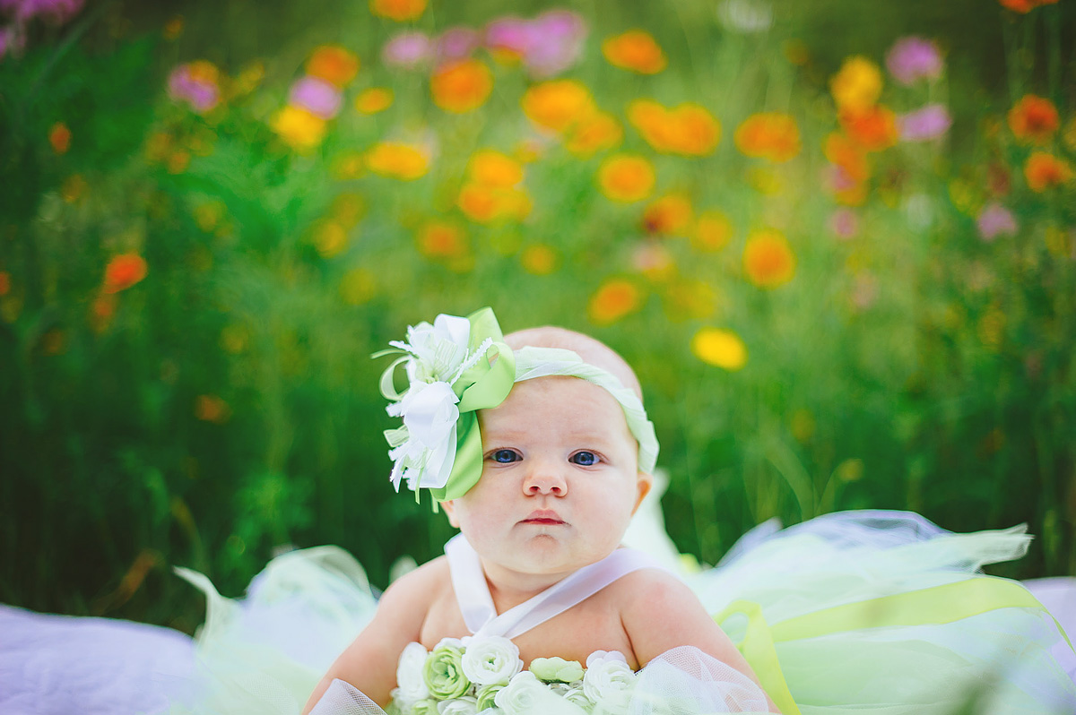 baby photo in tutu field of flowers