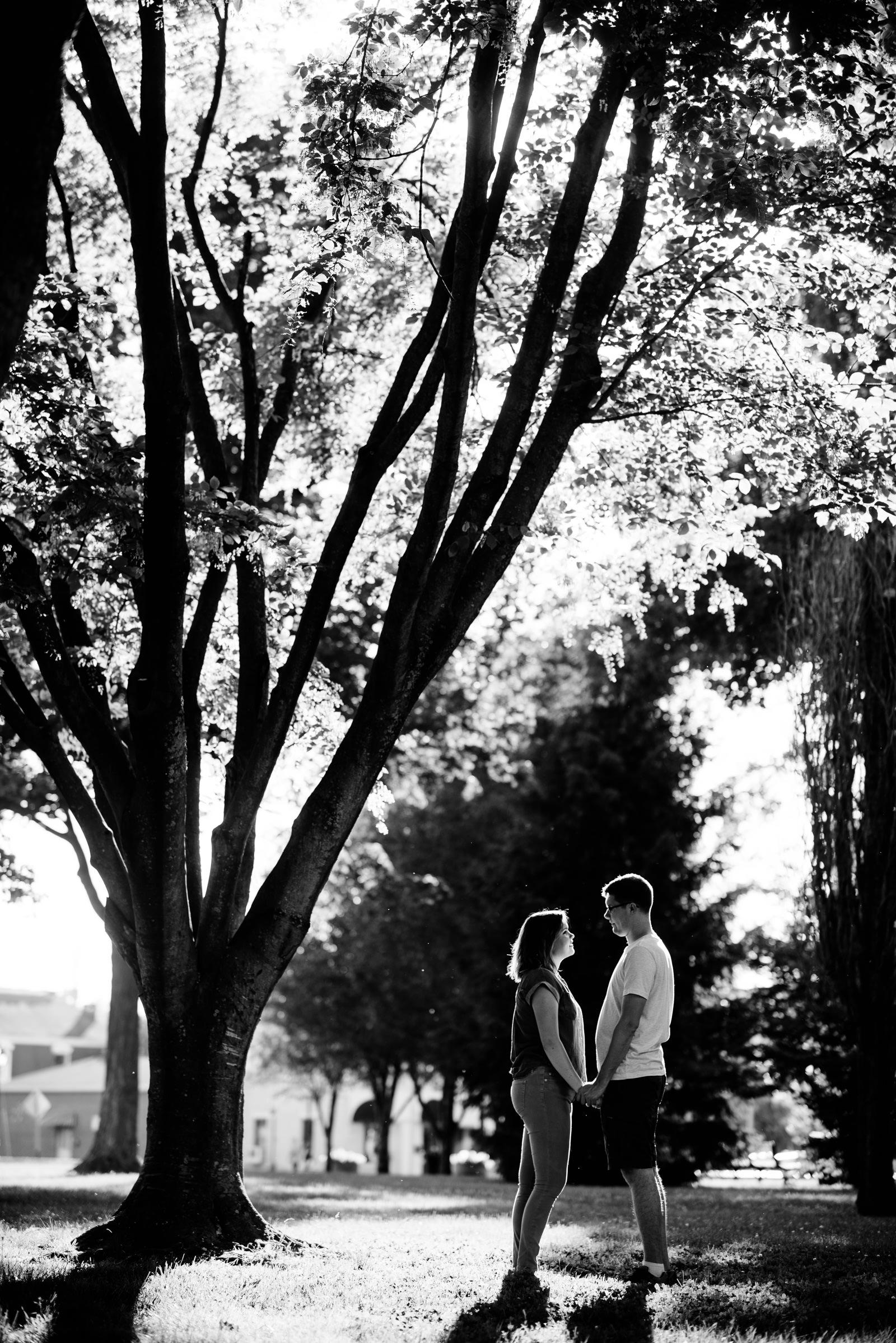 backlit engagement session in park