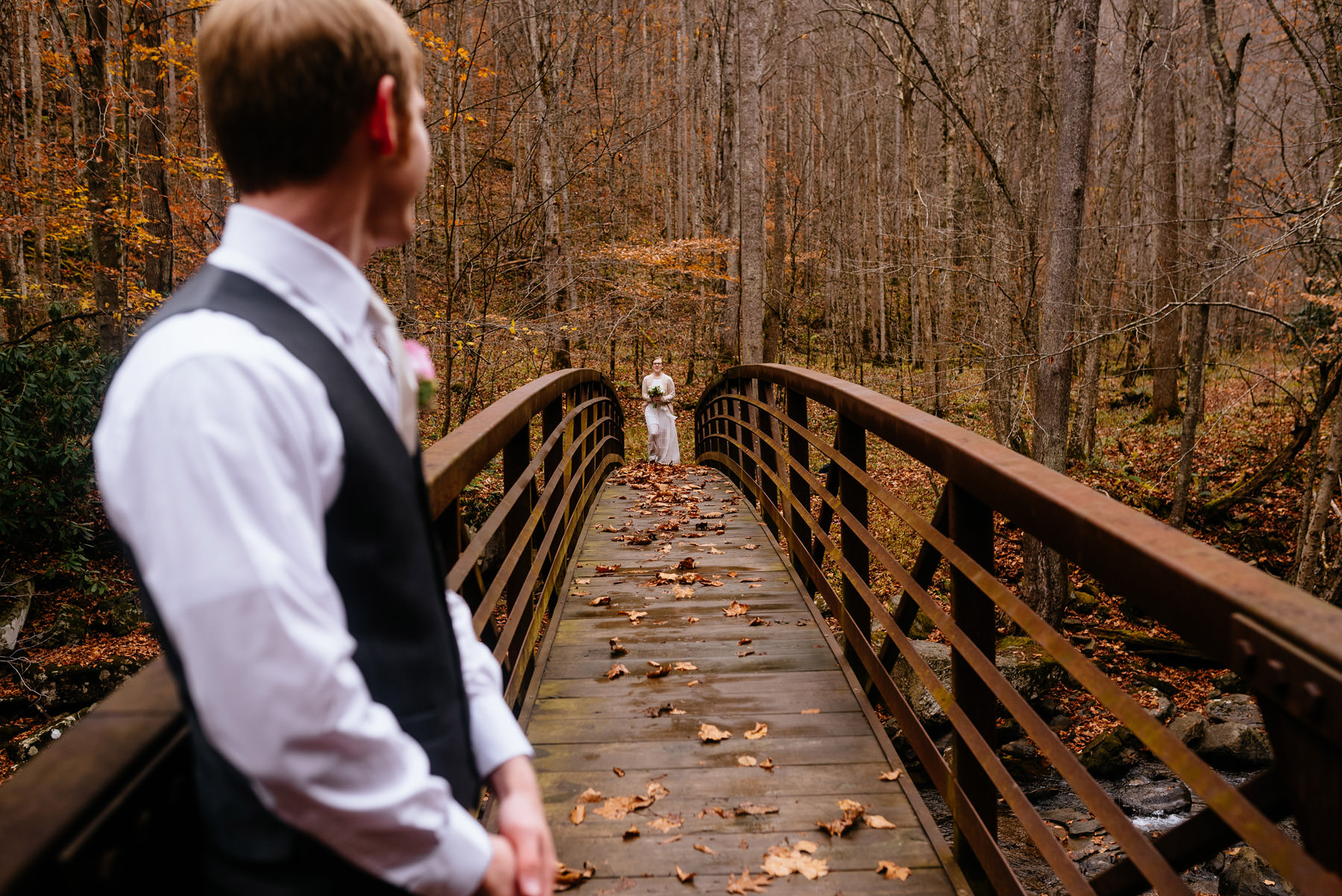bride entering ceremony on bridge wv hiking elopement
