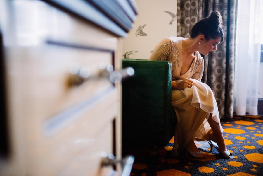 bride putting on shoes wedding photojournalism