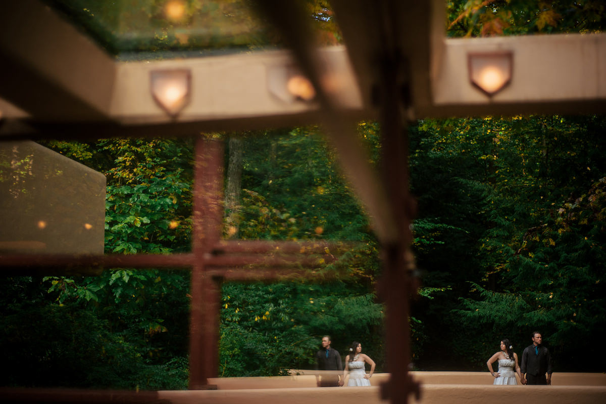 creative bride and groom portraits at fallingwater reflection