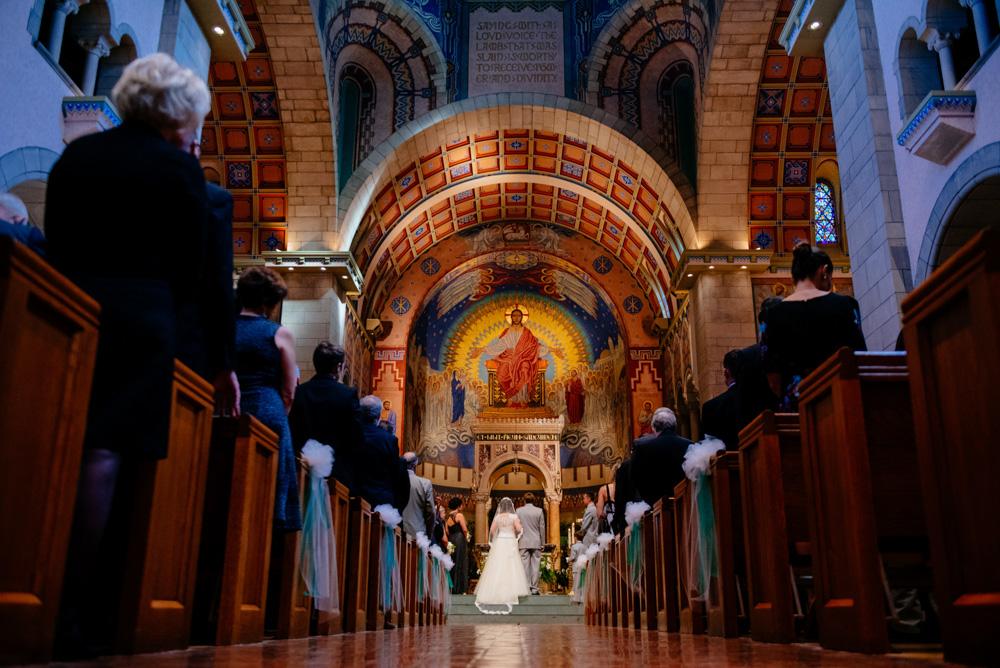 artistic wedding ceremony photos at saint josephs cathedral wheeling wv