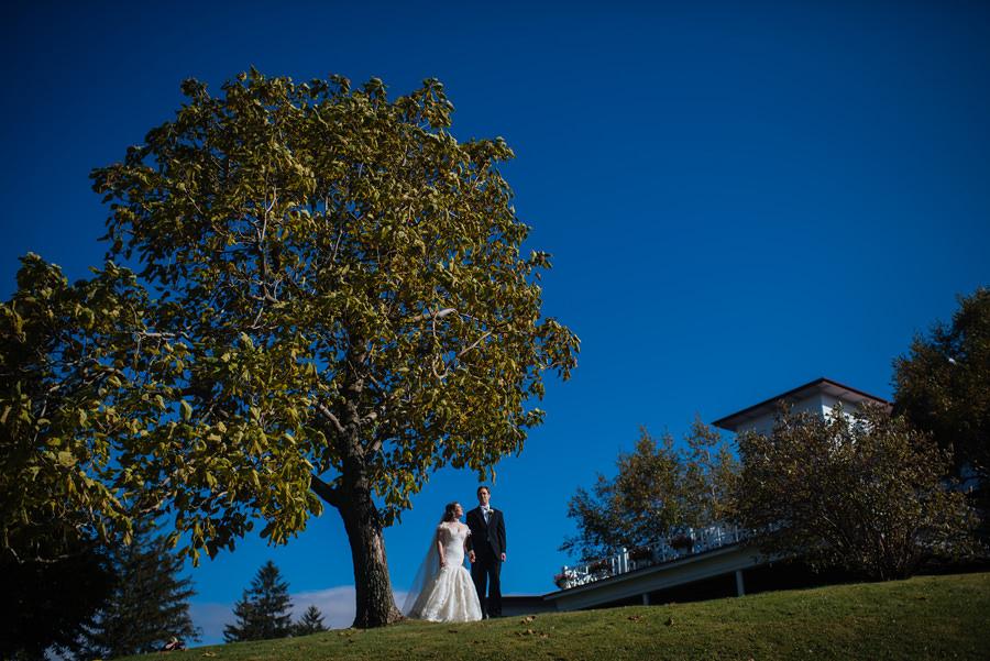 bride and groom in front of summit inn farmington pennsylvania
