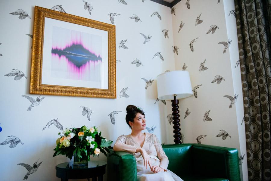 bride in vintage dress sitting in hotel monaco portland oregon