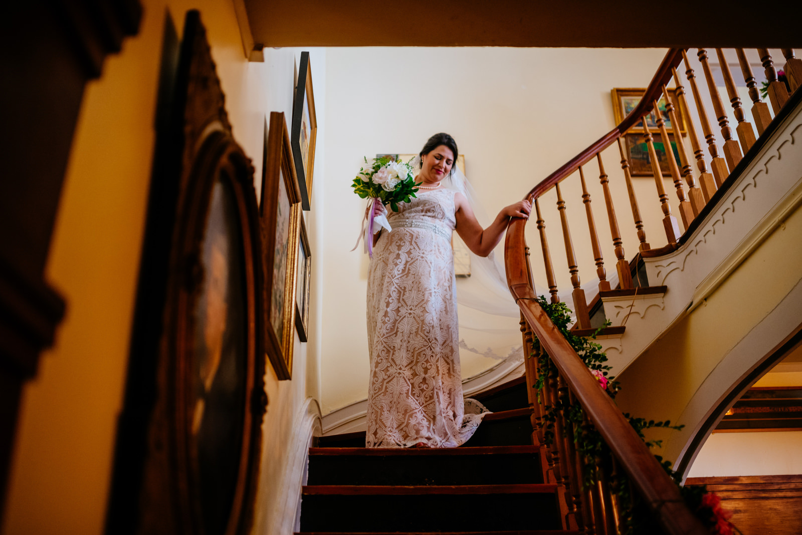 bride walks down stairs holly hill inn wedding lexington ky