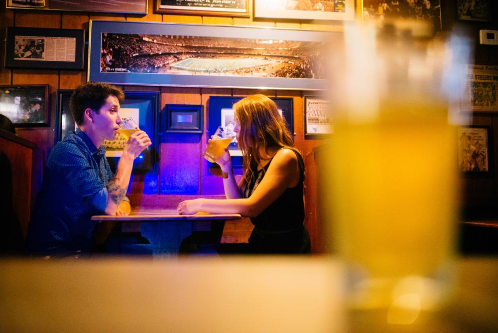 couple drinking craft beer engagement session genes beer garden morgantown wv