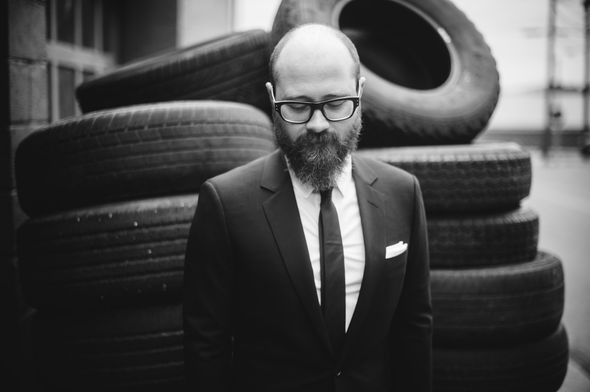 groom with beard portrait in front of tires