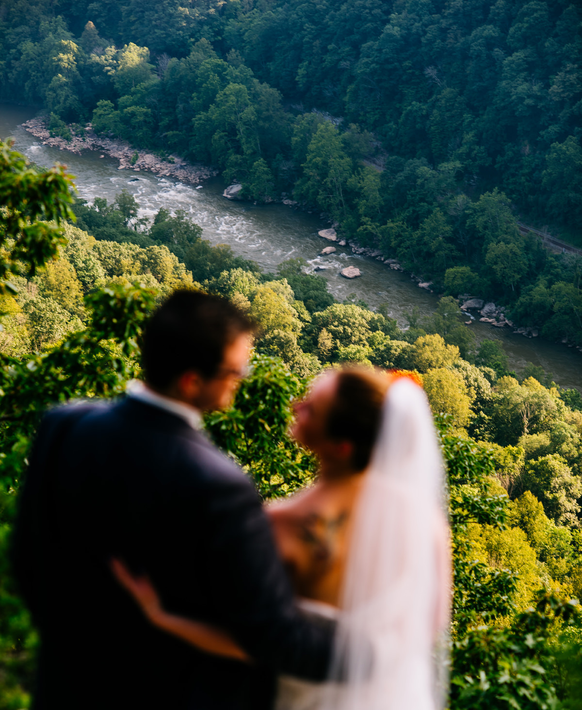 outdoorsy bride and groom who love rafting admire the new river