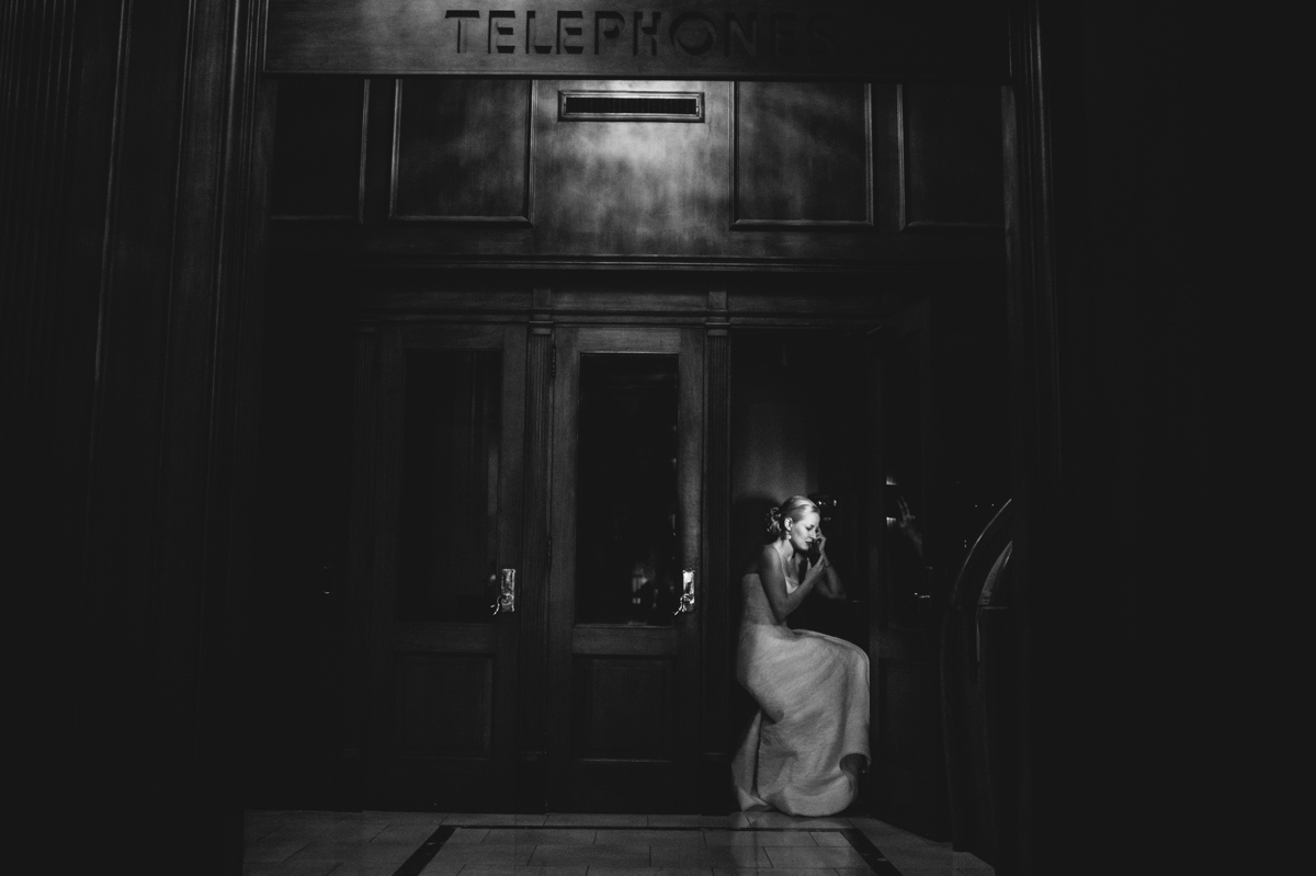 moody bridal portrait in old telephone booth
