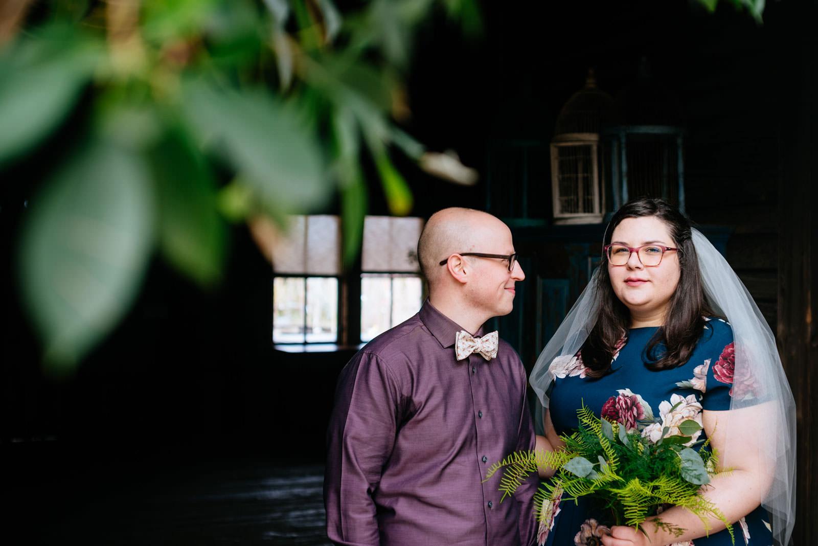 put a plant on it bride groom portrait