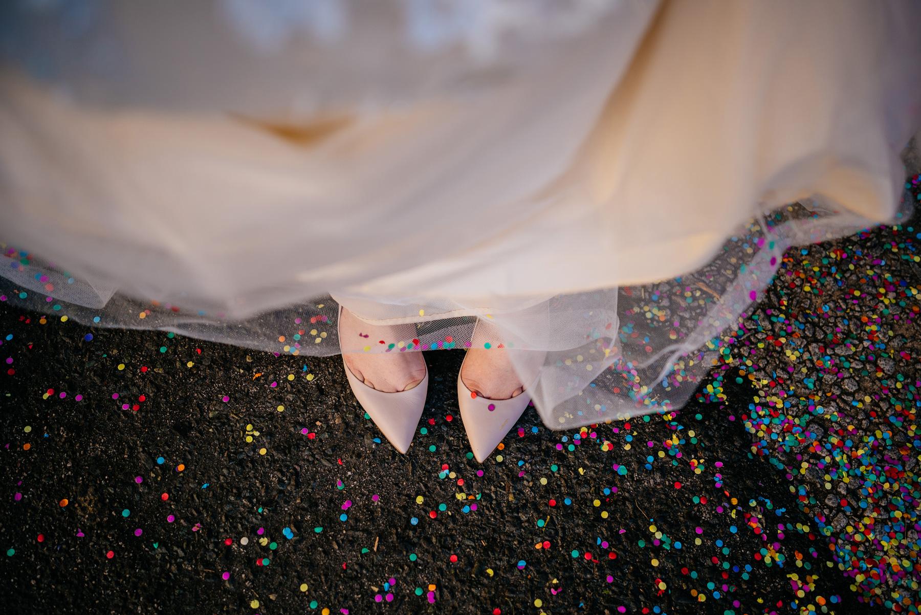 fun happy confetti wedding photos