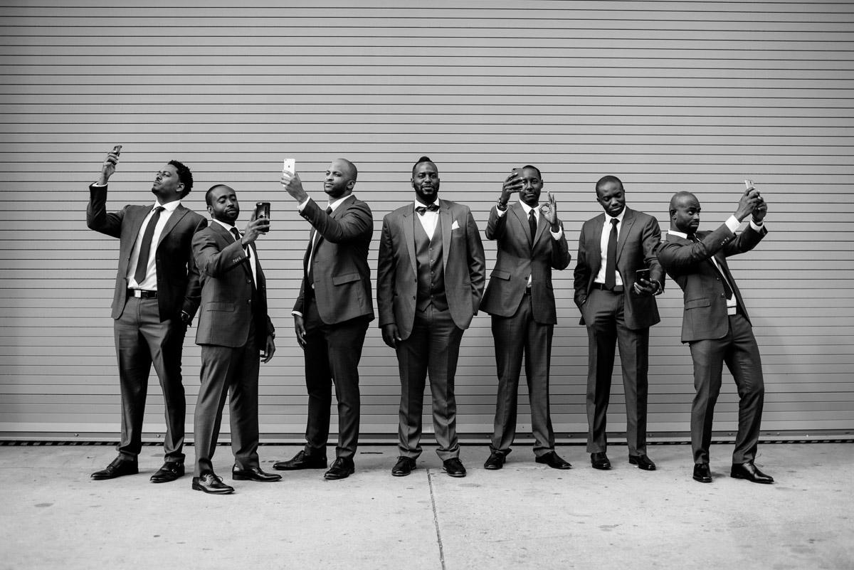groomsmen taking selfies portrait