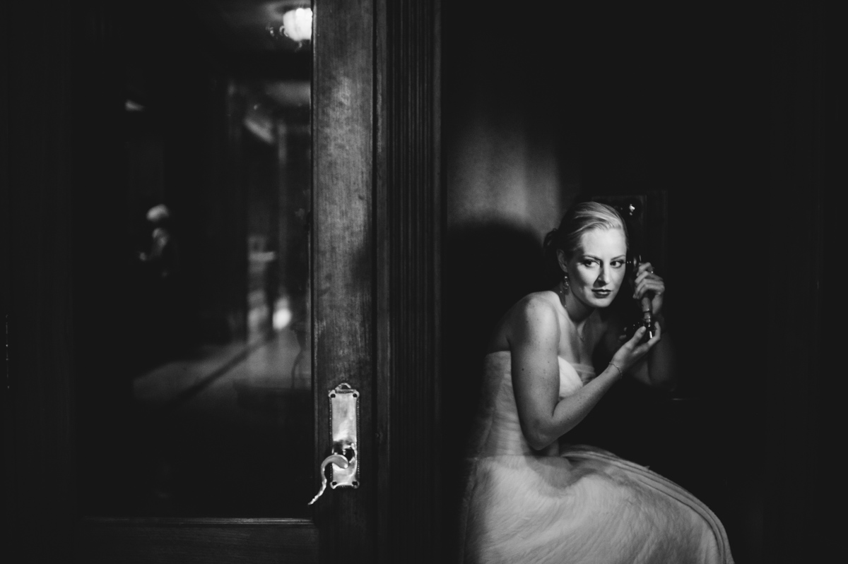 noir bridal portrait in old telephone booth