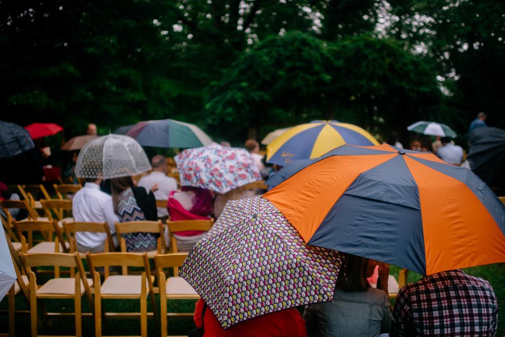 umbrellas rainy weding ceremony benedict haid wv