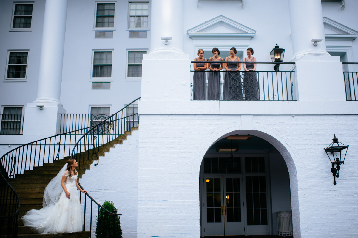 bride on stairs with bridesmaids at the greenbrier