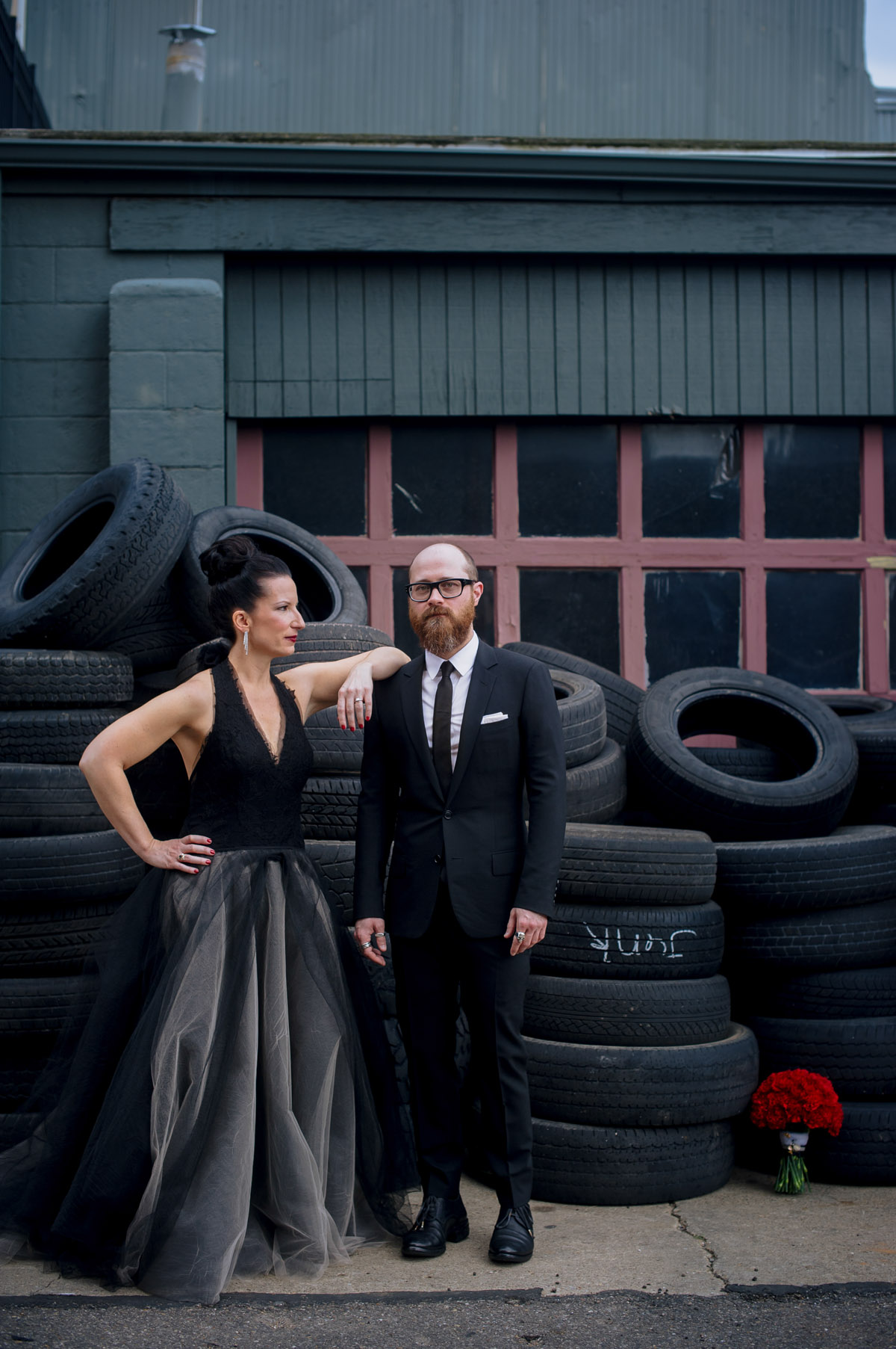 high fashion bride groom portrait in urban setting vera wang dior homme
