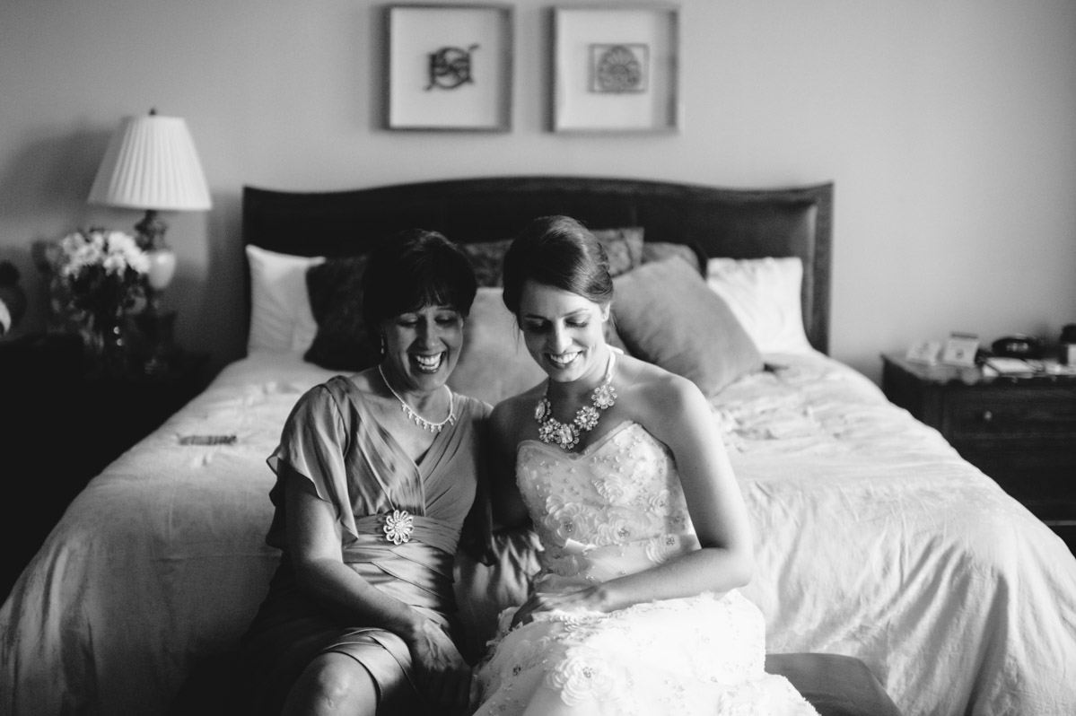 mother and daughter share a moment before wedding ceremony
