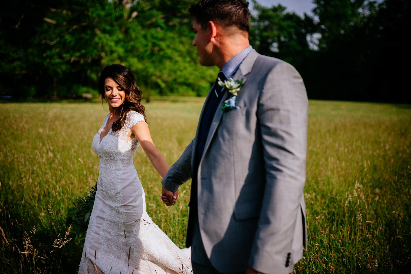walking through field gaines estate fayetteville wv wedding