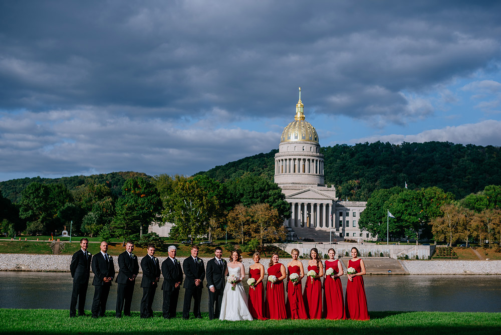 wedding party portrait on uc lawn overlooking wv state capitol gold dome