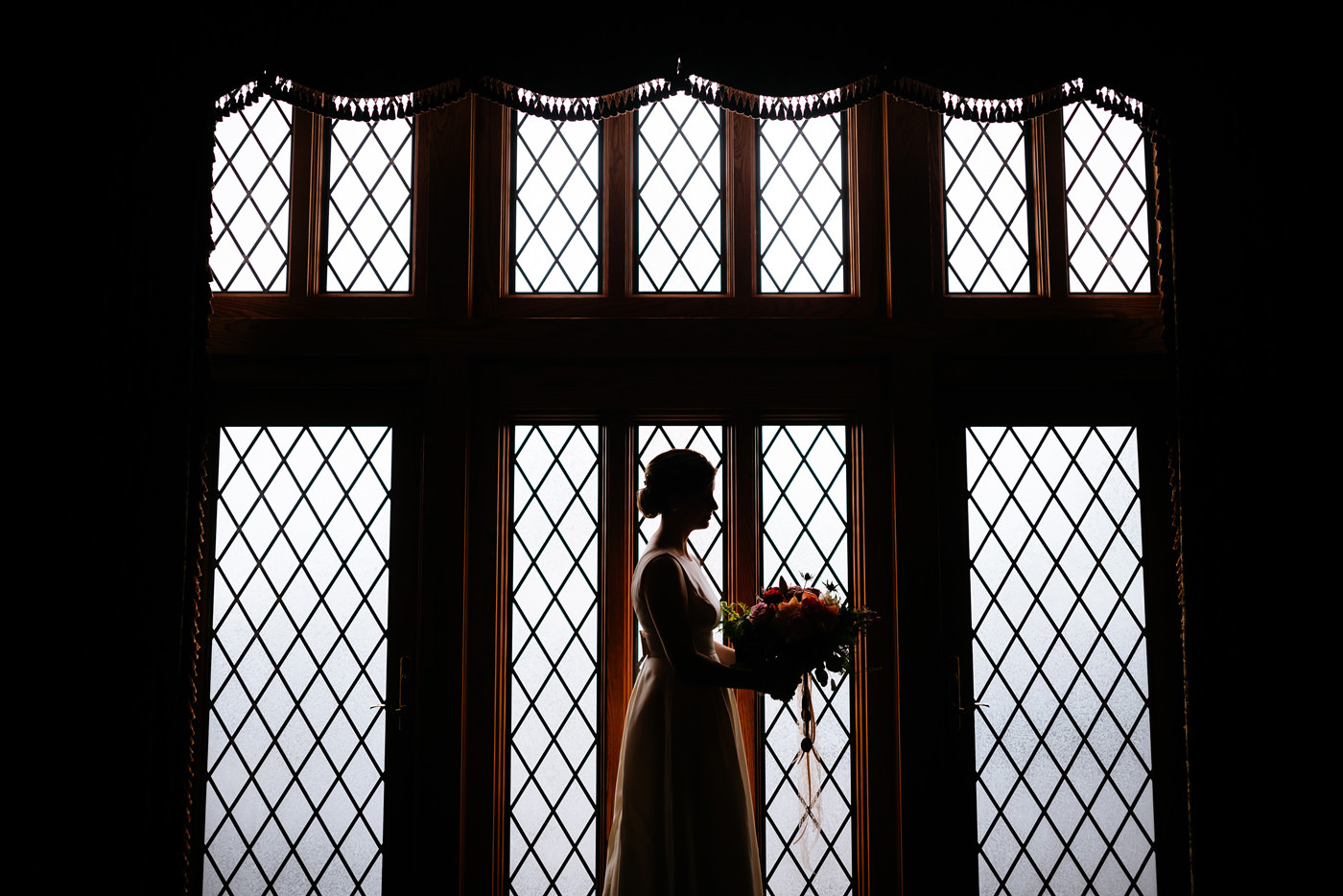 bride in front of cool window artistic bridal portrait pittsburgh pa wedding