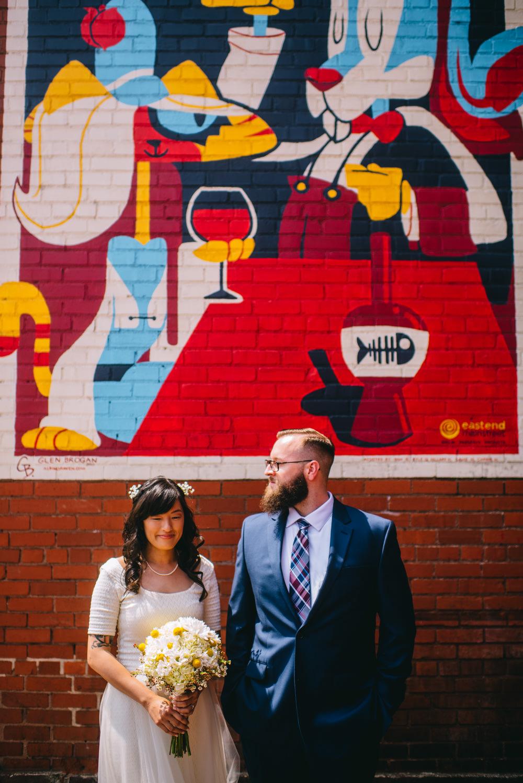 bride and groom in front of glen brogan mural chas wv