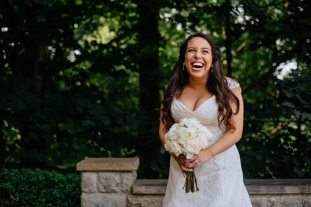bride laughing in the summertime