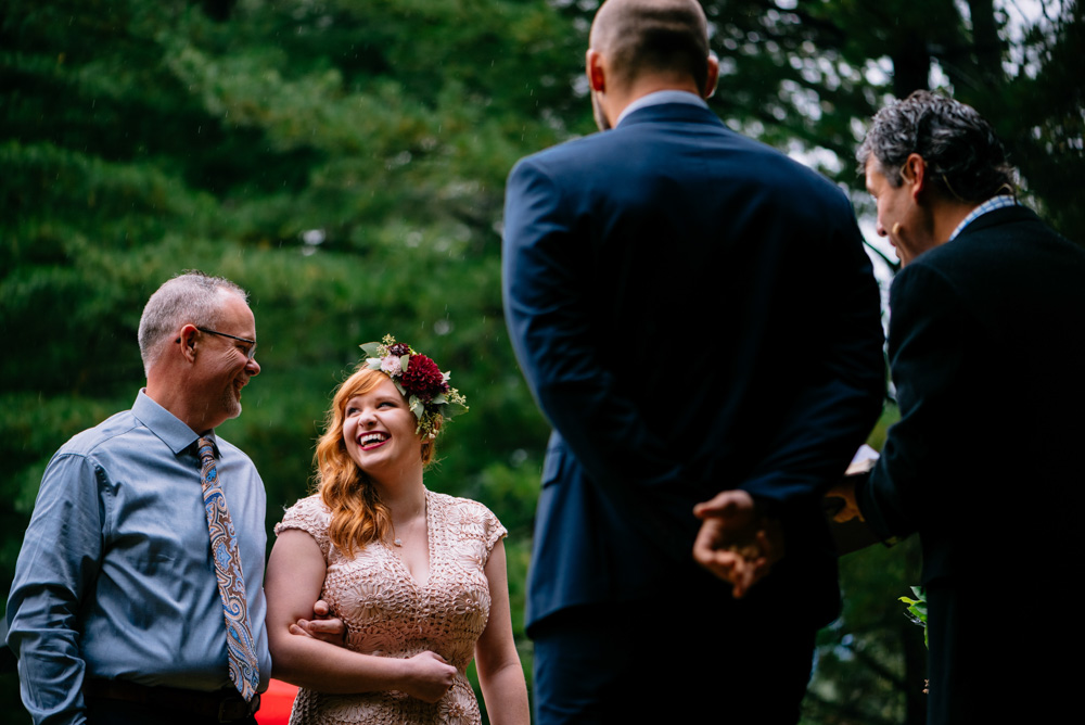 laughing bride father weddign ceremony at benedict haid wv by the oberports