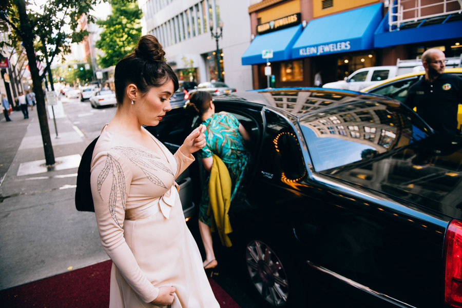 bride getting into limo wedding candid photojournalism