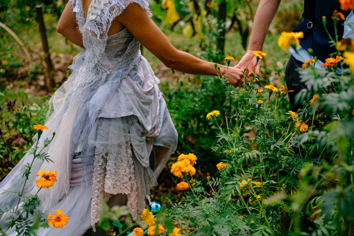 woodland punk rock wv wedding bride and groom walking through garden