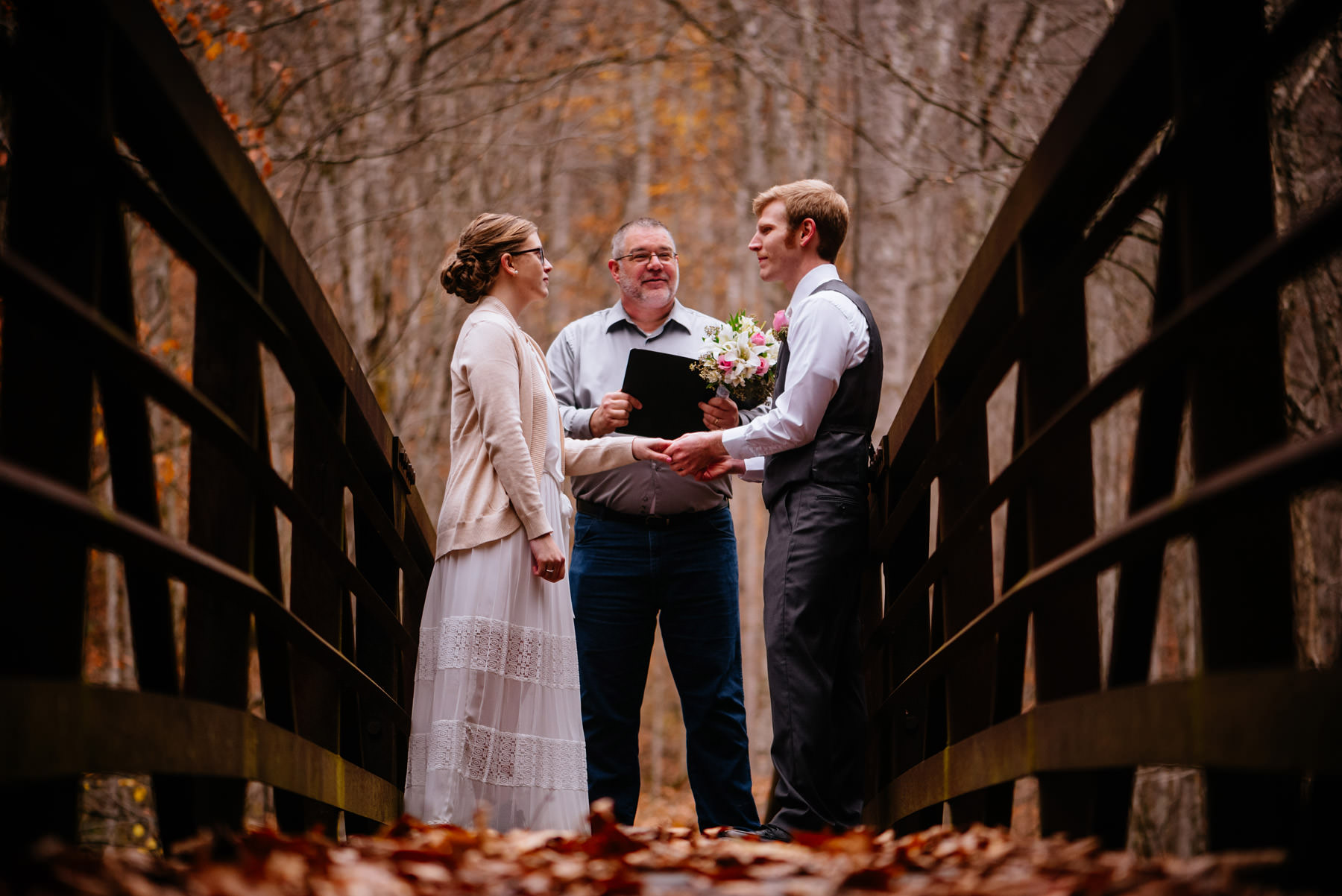 ceremony on bridge autumn wv hiking elopement