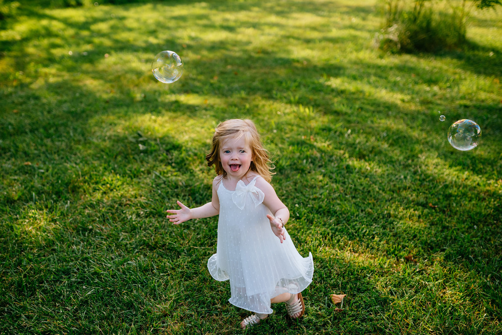 happy child with bubbles outdoor wedding