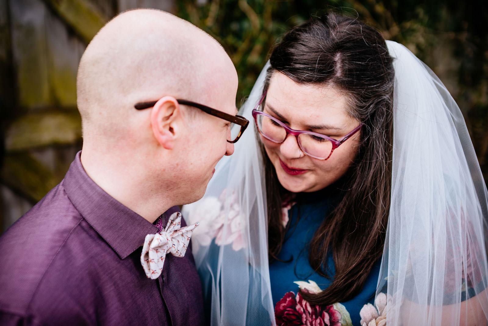 tender moment between bride groom