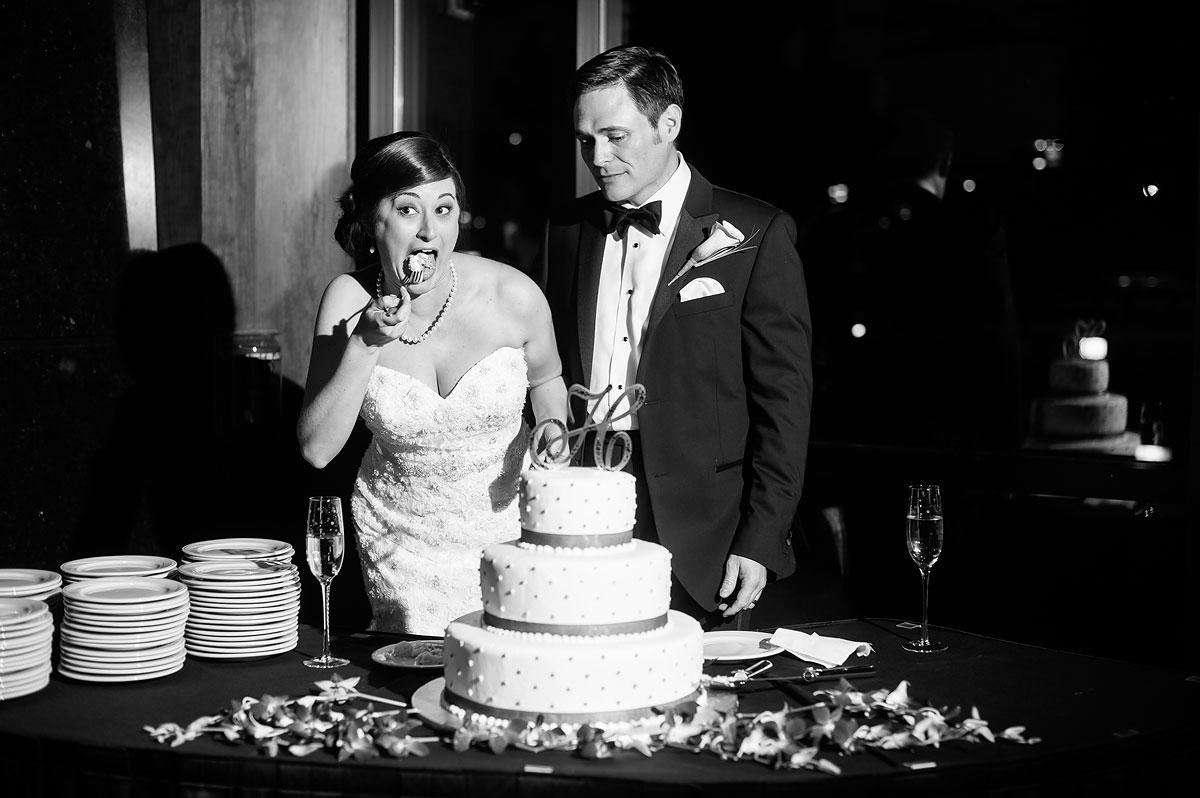 hilarious photo of bride eating wedding cake