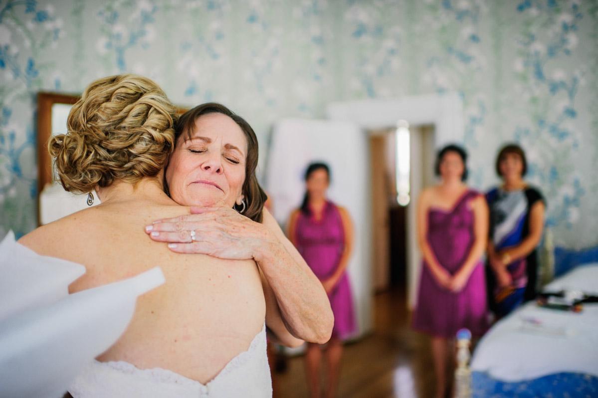 mom hug on wedding day