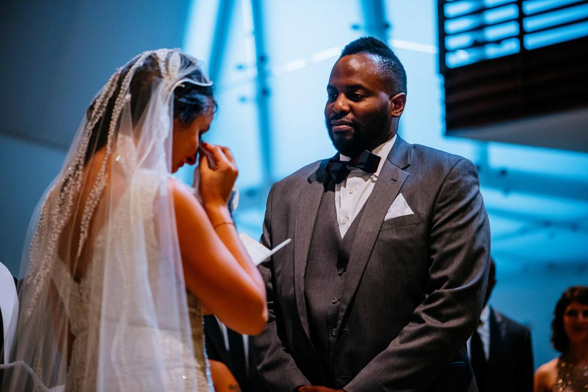 washington dc church wedding ceremony bride crying while reading vows
