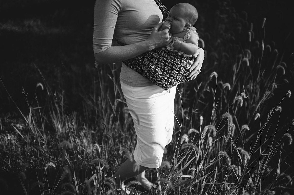 baby in sling while teething by pittsburgh photographers the oberports