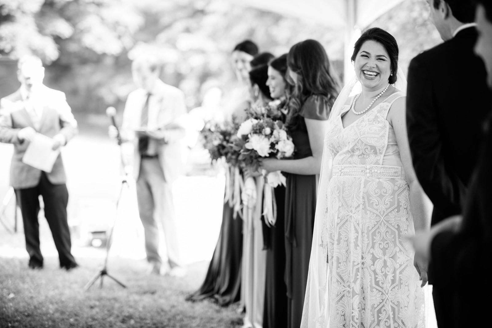 bride laughing during ceremony holly hill inn wedding lexington kentucky