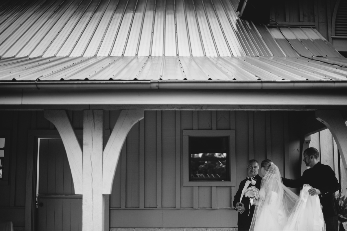 bride waits for ceremony with her dad