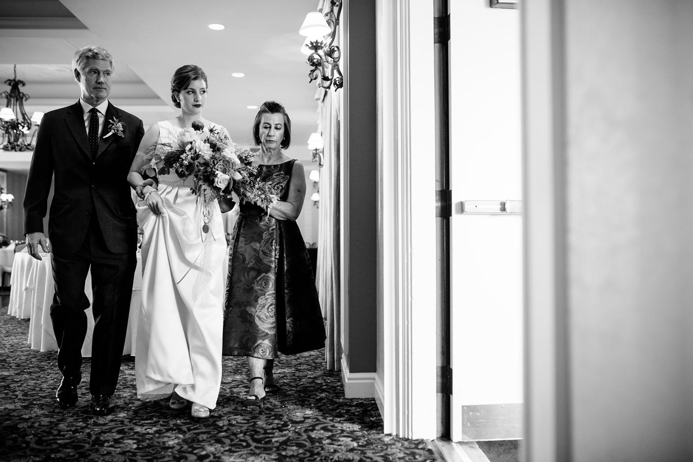 brides parents walking daughter down the aisle