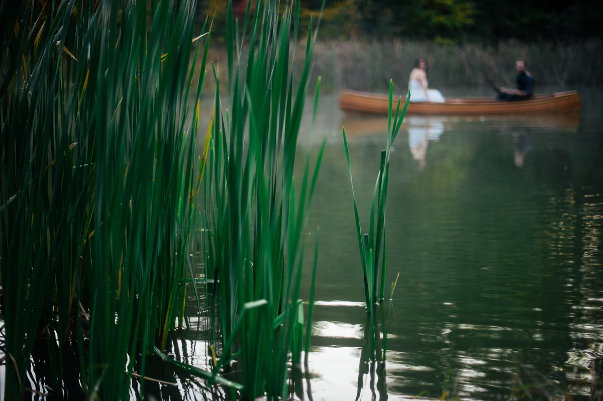 portrait of a bride and groom in canoe